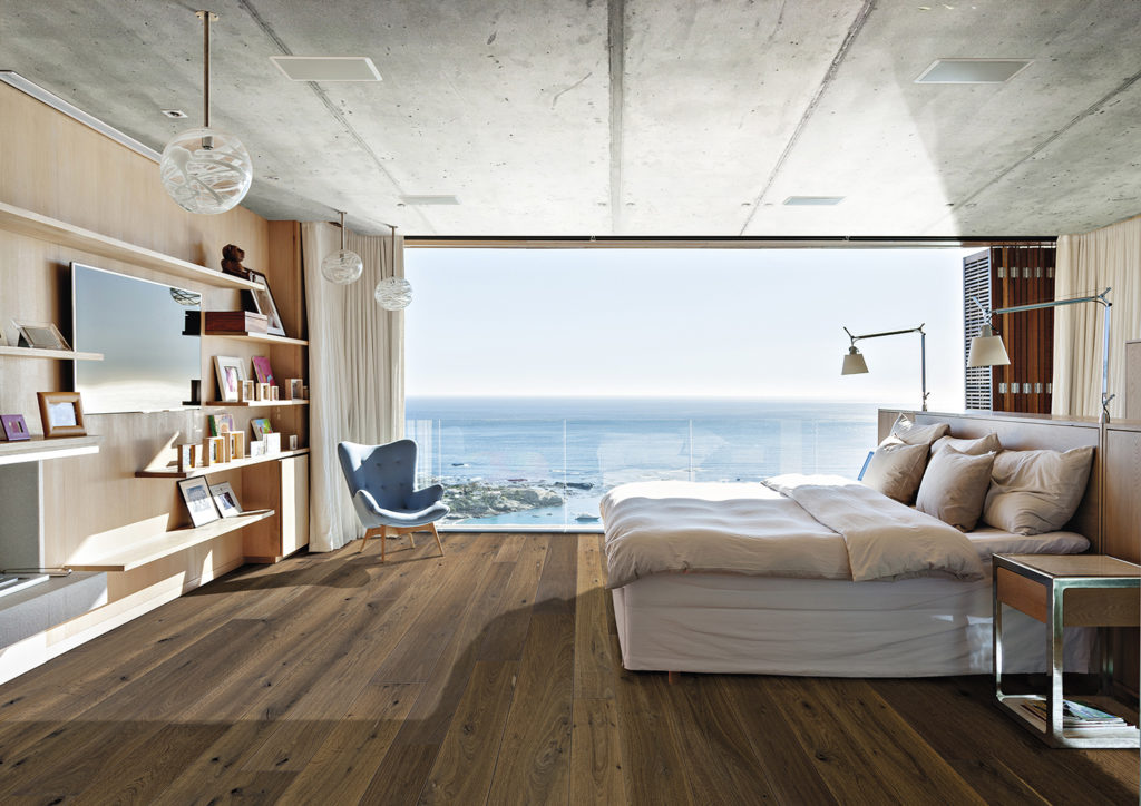 Sunny bedroom with ocean view